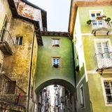 Architecture of the City of Cuneo. Architecture of the Medieval Piedmont City of Cuneo in Italy. Vintage Italian lamps and balconies in Mediterranean style Royalty Free Stock Photos