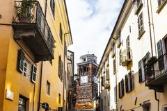 Architecture of the City of Cuneo. Architecture of the Medieval Piedmont City of Cuneo in Italy. Church with clock on the bell tower Stock Photography