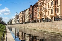 Granite embankment of the Admiralty Canal. Architecture of city embankments of rivers and canals Stock Image