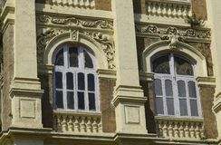 Architecture: Close up of a Building with Round Arched Windows Near Mumbai,India Royalty Free Stock Image