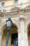 Architecture with columns and light post, Paris, France Stock Images