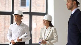 Architect or realtor showing office to customers. Architecture, construction business and people concept - architect or realtor showing new office room to stock footage
