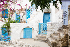 Architecture on the Cyclades. Greek Island buildings with her ty. Pical blue doors and white houses Stock Photography