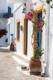 Architecture on the Cyclades. Greek Island buildings with her ty. Pical blue doors and white houses Royalty Free Stock Photos