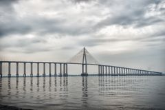 Architecture and design concept. Bridge over sea in manaus, brazil. Road passage over water on cloudy sky. Travel destination and royalty free stock images