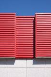 Architecture detail. Red metal finish of a modern building wall Royalty Free Stock Photos
