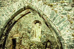 Architecture detail.  Arch old stone on fortress or church wall. Stone arch on fortress or church abbey wall. Old building architecture detail Royalty Free Stock Photos