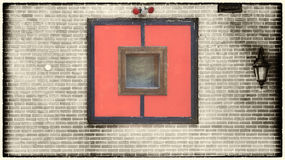 Architecture detail background. Red window shutters on a concrete wall background Royalty Free Stock Photo