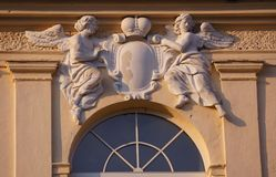 Architecture detail of basrelief with cherubs. Herb. Crown.Window. stock images
