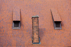 Architecture detail chimney and garret red tiles roof Stock Photo