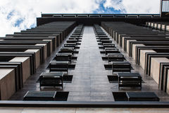 Architecture Detail, Modern Facade of Building. Underside panoramic and perspective view of skyscrapers high rising to the sky. Royalty Free Stock Photos
