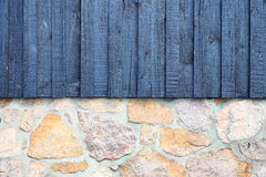 Architecture detail stone wall with wooden planks Stock Photos