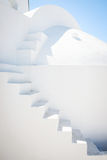 Architecture detail - white stairway, blue sky. Building with white stairway, blue sky in background, Santorini, Greece Royalty Free Stock Photos
