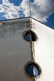 Architecture detail - window. The old round windows on a gray facade Royalty Free Stock Photos