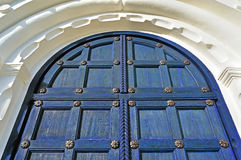 Architecture detailed background - aged wooden door of dark blue color Stock Photo