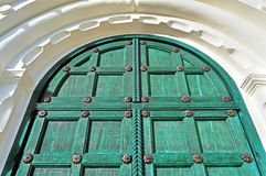 Architecture detailed background - aged wooden door of green color Royalty Free Stock Photos