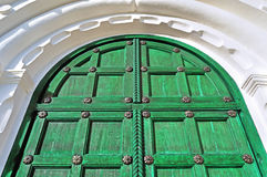 Architecture detailed background - aged wooden door of magenta color Stock Photo