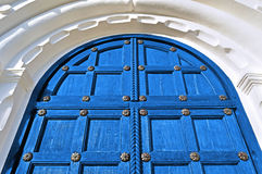 Architecture detailed background - aged wooden door of magenta color Royalty Free Stock Photo