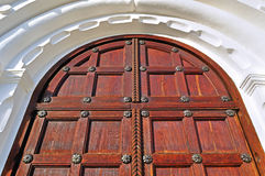 Architecture detailed background - aged wooden door of mahogany color Royalty Free Stock Images