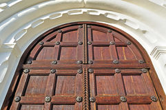Architecture detailed background - aged wooden door of natural color Stock Photos