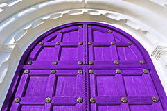 Architecture detailed background - aged wooden door of purple color Stock Photo