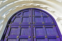 Architecture detailed background - aged wooden door of purple color Royalty Free Stock Image