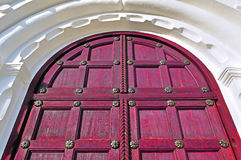 Architecture detailed background - aged wooden door of red color Royalty Free Stock Photos