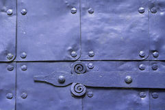 Architecture detailed background - aged wooden door of violet color Royalty Free Stock Photography