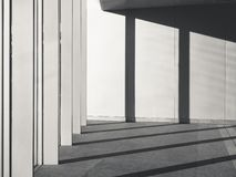 Architecture Details Cement concrete wall with Columns shade and shadow. Light Art Abstract stock photos