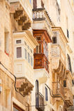 Architecture details of Malta. Traditional closed wooden balconies of Valletta city in Malta, Europe. UNESCO World Heritage Site Royalty Free Stock Photo