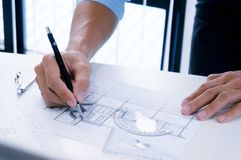Architecture drawing on architectural project business architect. Ure building construction and people concept stock photos