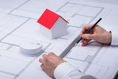 Architecture Drawing Blueprint. Near Smoke Detector And House Model stock photos