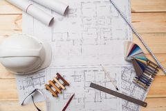 Architecture drawing desk, construction site working with blueprints in the office top view stock photo