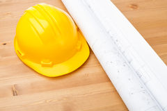 Architecture drawing and safety helmet Stock Photography