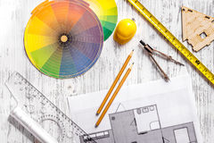 Architecture drawing and tools on light wooden desk top view Stock Image