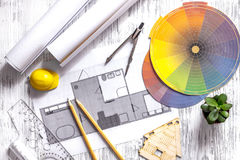 Architecture drawing and tools on light wooden desk top view Stock Photos