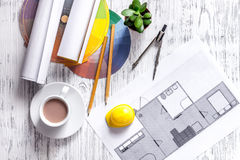 Architecture drawing and tools on light wooden desk top view Royalty Free Stock Images
