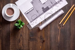 Architecture drawing and tools on wooden desk top view copyspace Stock Photo