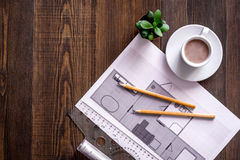 Architecture drawing and tools on wooden desk top view copyspace Royalty Free Stock Photos
