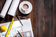 Architecture drawing and tools on wooden desk top view copyspace Royalty Free Stock Photography