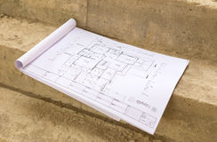 Architecture drawings in hand on house building Royalty Free Stock Photo