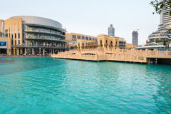 Architecture of Dubai Mall, overlooking a clear, blue, decorativ Royalty Free Stock Images