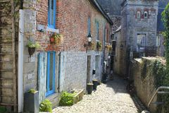 Architecture in Durbuy, Belgium. Narrow street, building with blue windows. Durbuy is a Walloon city and municipality located in the Belgian province of stock photo