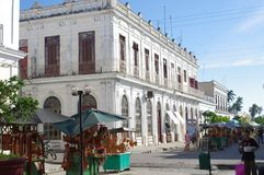 Architecture of  early 19th century Spanish Enlightenment implementation in urban planning. Pedestrian friendly street in Cienfuegos, Cuba, the best example of Stock Photo