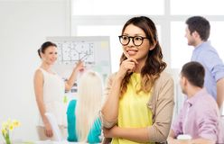 Happy asian woman in glasses or student. Architecture, education and business concept - happy asian women in glasses or student over architectural bureau stock photo