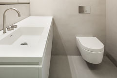 Architecture, empty bathroom. In cement of new apartment Stock Photography