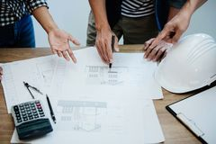 Architecture Engineer Teamwork Meeting, Drawing and working for architectural project and engineering tools on workplace, concept royalty free stock image