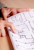 Architecture and engineering. Hand of a woman pointing to some architectural drawings royalty free stock photography