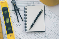 Architecture, engineering plans and drawing equipment Royalty Free Stock Photos