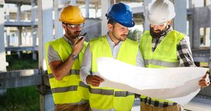 Architecture engineering teamwork meeting at workplace. Architecture engineering teamwork meeting at building site royalty free stock image